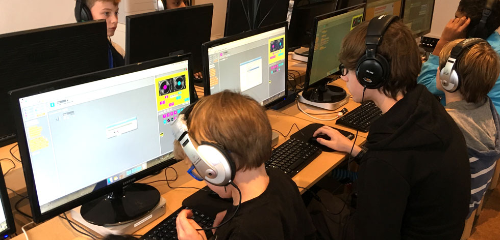 Students creating a DJ game with Scratch