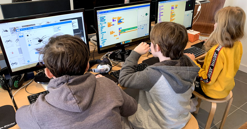 Student creating a game with Scratch