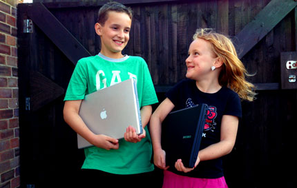 brother and sister with laptops